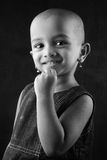 Portrait of an Indian girl child. Black and white portrait of an Indian girl child with shaved head Stock Photos