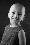 Portrait of an Indian girl child. Black and white portrait of an Indian girl child with shaved head Royalty Free Stock Images