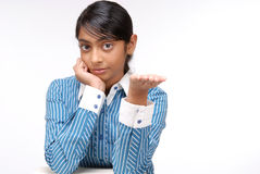 Portrait of Indian girl showing something Stock Photo