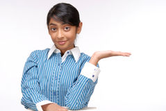 Portrait of Indian girl showing something Royalty Free Stock Photo