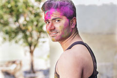 Portrait of Indian guy with colorful paint on face Stock Photos