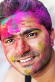 Portrait of Indian guy with colorful paint on face Royalty Free Stock Images