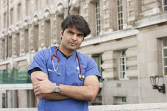 Portrait of an Indian male doctor standing with arms crossed Royalty Free Stock Photography