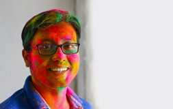 Portrait of indian man face painted with colors smiling with eyes open space for text stock photography