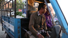 Portrait of Indian man sitting inside of a truck at street in Jodhpur. JODHPUR, INDIA - 12 FEBRUARY 2015: Portrait of Indian man sitting inside of a truck at stock video