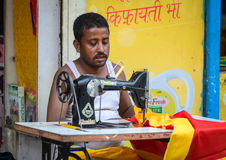 Portrait of Indian man tailor at work place Stock Images