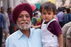 Portrait of indian man with young boy walking at Chandni Chowk, Royalty Free Stock Photo