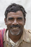 Portrait indian poor man. New Delhi, India. NEW DELHI, INDIA - JANUARY 23, 2017 : Indian poor man came to see preparations for the India Day parade in New Delhi royalty free stock images