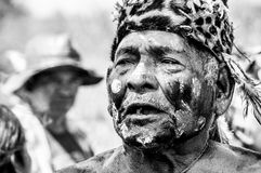 Portrait of Indigenous chief in Paraguayan community. Puerto Pollo, Paraguay on August 8, 2015: Old Paraguayan indigenous man with face paintings from the Yshir Stock Images