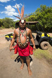 Portrait of Indigenous man wearing a hat made of feathers and ca Royalty Free Stock Images
