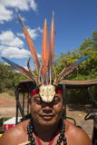Portrait of Indigenous man wearing a hat made of feathers and ca Stock Image