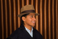 Portrait of indigenous young man wearing traditional hat and poncho from Otavalo, Ecuador Stock Image