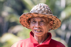Portrait of an indonesian farmer smiling. royalty free stock photos