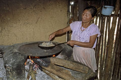 Portrait of indoor cooking Guatemalan woman Stock Images