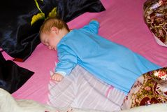 Sleeping baby boy face down at home. Portrait of an infant in bright colors Royalty Free Stock Images