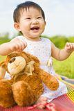 Portrait of a infant girl outdoor in the park Stock Images