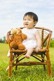 Portrait of a infant girl outdoor in the park Royalty Free Stock Photos