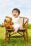 Portrait of a infant girl outdoor in the park Stock Photos