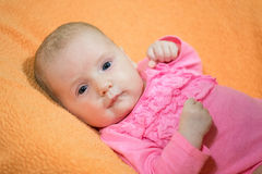 Portrait of a infant. Infant lies on the blanket. Stock Image
