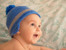 Portrait of an infant in a knitted hat. Stock Photo