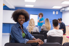 Portrait informal African American business woman. Portrait of young African American business women at modern startup office interior, team in meeting in Stock Photos