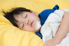 Portrait of injury boy sleeping Stock Photography