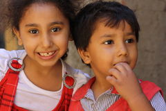 Portrait of an innocent children close up at charity event in giza, egypt. Portrait of an innocent children brother and sister close up at charity event in giza Stock Photos