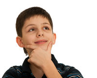 Portrait of an inspired thoughtful boy. A boy with spiritual gesture is thinking; isolated on the white background Royalty Free Stock Photo