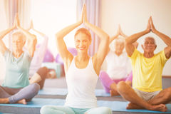 Portrait of instructor performing yoga. With seniors during sports class Royalty Free Stock Image