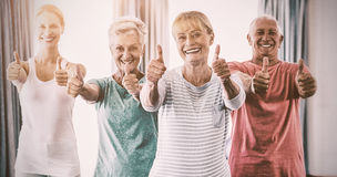 Portrait of instructor and seniors with thumbs up Stock Photo
