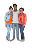 Portrait intégral de trois jeunes amis frais Photographie stock