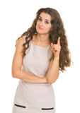 Portrait of interested woman pointing on fact Stock Image