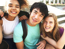 Portrait of international group of students close up smiling, bl. Ond girl, asian boy, young african woman, back to school Stock Image