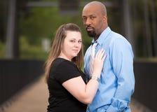 Portrait of an interracial couple Stock Photos