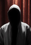 Portrait of Invisible man in the hood with curtain Royalty Free Stock Images