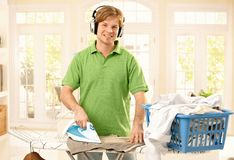 Portrait of ironing man Royalty Free Stock Photography