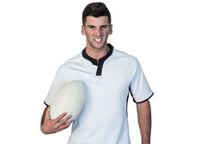 Portrait of an irritated rugby holding ball Stock Photography