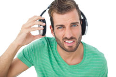 Portrait of a irritated young man with headphones Royalty Free Stock Photos