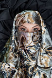 Portrait of islam woman in hijab, chador on dark backgound. Woman in hijab, chador  on dark backgound Royalty Free Stock Photos