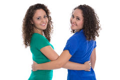 Portrait of an isolated couple of real twin sisters over white w Stock Photography