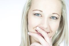 Portrait of an isolated friendly blond woman with blue eyes in a Stock Photography