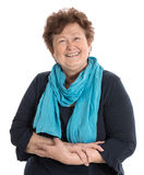Portrait: Isolated happy pensioner woman wearing blue and turquoise clothes. royalty free stock photos