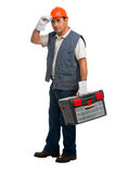 Portrait Isolated manual worker carrying a toolbox Stock Photo