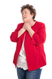 Portrait: Isolated older woman in red has sore throat. Royalty Free Stock Photos