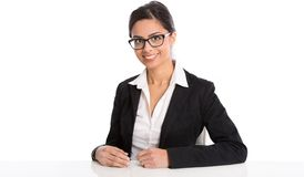 Portrait of isolated sitting smiling businesswoman with glasses Royalty Free Stock Photography