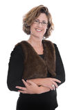 Portrait: Isolated smiling middle aged business woman. Over white wearing black jacket Stock Photos