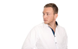 Portrait: Isolated unhappy blond man looking disappointed sidewa. Ys to text Royalty Free Stock Image
