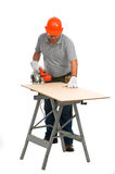 Portrait isolated worker using electric handsaw Stock Images