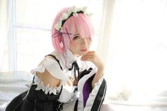 Portrait of Japan anime cosplay woman, white japanese maid in white tone room. Portrait of Japan anime cosplay woman, white japanese maid in white room stock images