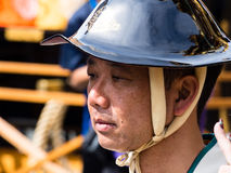 Portrait of a Japanese man in traditional clothes with lacquered helmet Royalty Free Stock Images